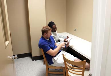 Two students work in a study carrel.